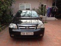 Gia đình cần bán xe Daewoo Lacetti EX đời 2009, màu đen