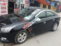 Cần bán xe cũ Chevrolet Cruze LS đời 2012, màu đen xe gia đình, 405 triệu
