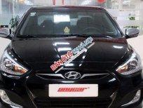 Cần bán xe Hyundai Accent Blue 1.4AT đời 2013, màu đen, 514tr