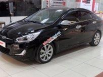 Bán Hyundai Accent Blue 1.4AT năm 2013, màu đen