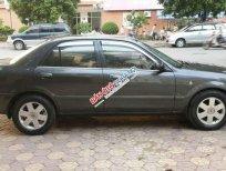 Bán xe Ford Laser 1.6 MT đời 2002, màu xám