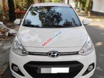 Bán Hyundai Grand i10 1.0AT đời 2014, màu trắng,Hỗ trợ trả góp ngân hàng 90%
