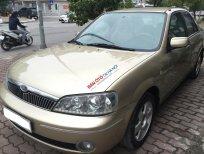 Bán ô tô Ford Laser 1.8MT năm 2003, màu vàng cát, giá chỉ 195 triệu