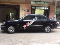 Cần bán lại xe Ford Laser Ghia 1.8 sản xuất 2004, màu đen số tự động