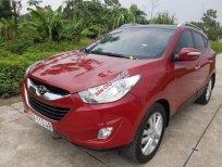 Cần bán Hyundai Tucson 2.0AT năm sản xuất 2010, màu đỏ, nhập khẩu nguyên chiếc chính chủ