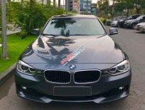 Chính chủ cần bán xe BMW 3 Series 320i model 2014, màu nòng súng, xe nhập