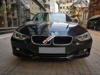 Bán ô tô BMW 3 Series 320i model 2013, màu đen, nhập khẩu, một chủ mua mới từ đầu