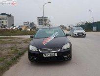 Cần bán Focus số sàn 1.8L màu đen, sản xuất và đăng ký 2009