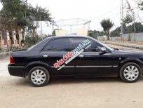 Bán Ford Laser 1.8MT đời 2004, màu đen chính chủ, giá tốt