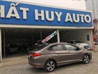 Cần bán Honda City 1.5AT đời 2015, màu nâu