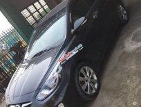 Cần bán Hyundai Accent 1.4 AT đời 2011, màu đen, xe nhập