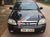 Cần bán gấp Daewoo Lacetti MT năm 2004, màu đen, xe rất đẹp