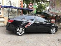 Cần bán Kia Cerato 1.6AT sản xuất năm 2011, màu đen, nhập khẩu