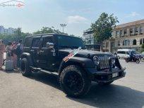 Bán Jeep Wrangler Unlimited Sport 3.6 AT sản xuất 2015, màu đen, xe nhập
