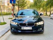 Bán xe BMW 3 Series 320i sản xuất năm 2014, màu đen, xe nhập, 850 triệu