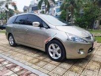 Cần bán Mitsubishi Grandis 2.4 AT năm sản xuất 2009, màu vàng