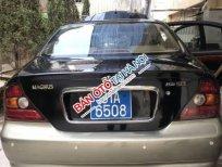 Cần bán xe Daewoo Magnus năm sản xuất 2004, màu đen, nhập khẩu