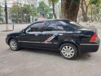 Cần bán lại xe Ford Laser 1.8 AT đời 2005, màu đen