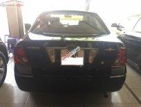 Xe Ford Laser GHIA 1.8 AT sản xuất năm 2004, màu đen chính chủ