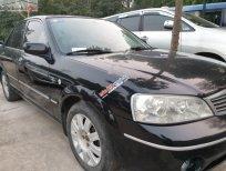 Bán Ford Laser 1.8 AT ghia đời 2005, màu đen số tự động, giá chỉ 199 triệu