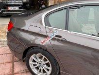 Cần bán xe BMW 3 Series 320i năm 2012, màu nâu, nhập khẩu, giá 700tr