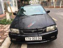 Bán xe Mazda 323 đời 2001, màu đen như mới, 69tr