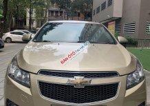 Cần bán gấp Chevrolet Cruze MT đời 2012, màu vàng, nhập khẩu xe gia đình